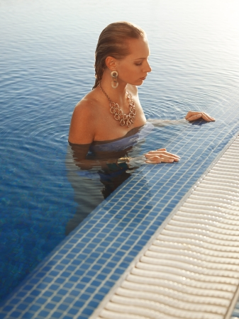 females only: Girl relaxing in swimming pool