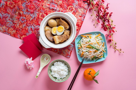Vietnamese food for Tet holiday in spring, it is traditional food on lunar new year: pork belly with hard-boiled eggs in coconut water, mixed pickles, rice Standard-Bild