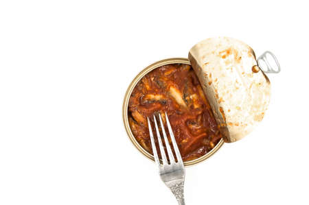 Canned fish in tomato sauce on white background Stock Photo