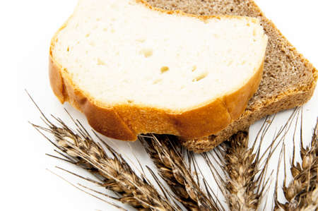white, black bread, on a background of wheat, on a white background Stock Photo