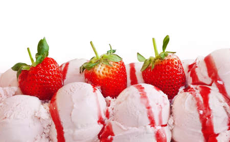 balls of strawberry ice cream and fruit isolated on white background  photo