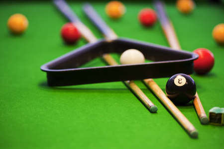 billiards tables: Pool game on green table Stock Photo