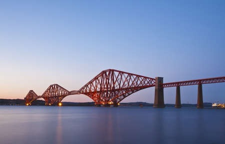 The Forth Rail Bridge crossing between Fife and Edinburgh, Scotland. Night scene photo
