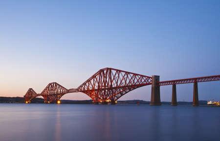 rail cross: The Forth Rail Bridge crossing between Fife and Edinburgh, Scotland. Night scene