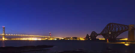 The Forth Road and Rail Bridges panoramic image in evening light.