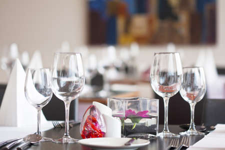 Formal dining table set up with flower in luxury restaurant  Stock Photo