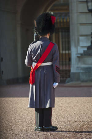 Royal Grenadier guard wearing winter greatcoat at Buckingham palace photo