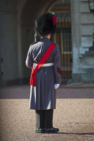 ceremonial clothing: Royal Grenadier guard wearing winter greatcoat at Buckingham palace