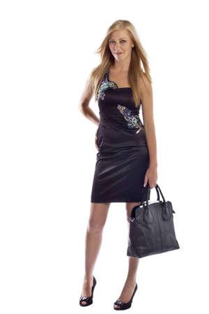 Beautiful young female Model holding bag posing  Isolated on white Stock Photo - 14461004
