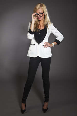 studio shot portrait of a young blond caucasian business woman in smart outfit wearing glasses Stock Photo - 14461013