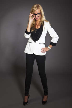 studio shot portrait of a young blond caucasian business woman in smart outfit wearing glasses Stock Photo - 14461022