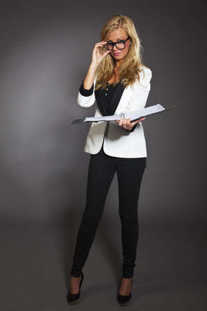 studio shot portrait of a young blond caucasian business woman in smart outfit wearing glasses Stock Photo - 14461021