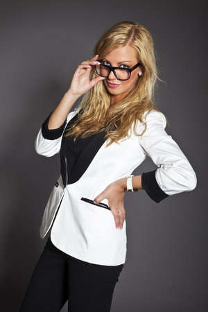 studio shot portrait of a young blond caucasian business woman in smart outfit wearing glasses Stock Photo - 14461011