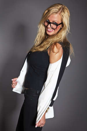 studio shot portrait of a young blond caucasian business woman in smart outfit wearing glasses Stock Photo - 14461015