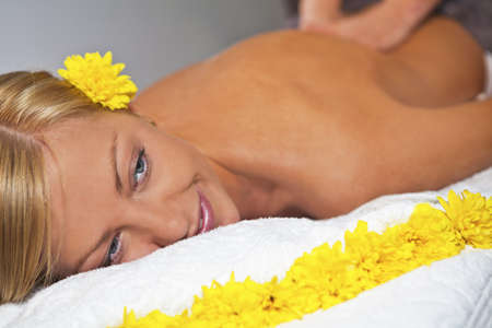 Young blond caucasian woman receiving back massage at Beauty Spa salon  Horisontal Stock Photo - 14470930