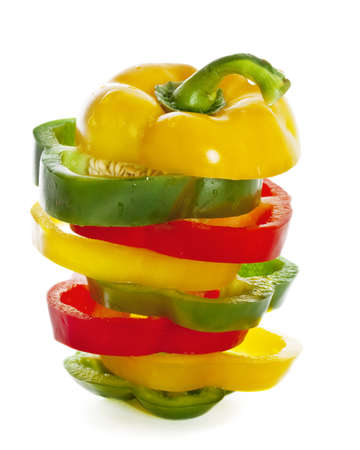 Sprinkled fresh green, yellow and red paprikas sliced and mixed  Isolated on White Stock Photo - 14509977