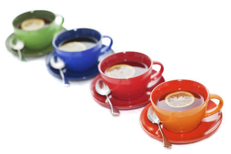 cup four: Colored tea cups lined up in diagonal order. Tea with lemon