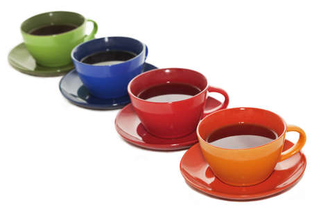 Colored tea cups lined up in pespective order photo