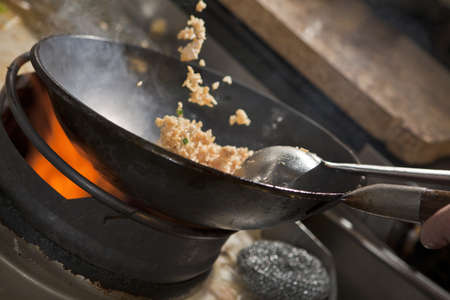 pan fried: Closeup of fried rice being cooked in wok