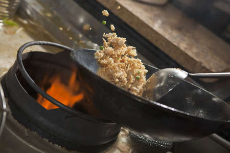 culinary skills: Closeup of fried rice being cooked in wok