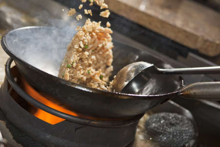 stir fry: Closeup of fried rice being cooked in wok  Stock Photo