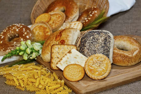 Various baked goods with a cutting board, pasta and cereal ears Stock Photo - 14627217