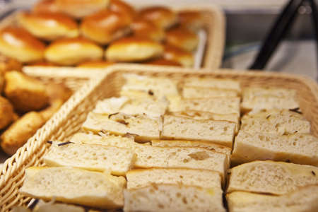 Fresh cuts of Focaccia bread in basket with rolls on the background Stock Photo - 14627196