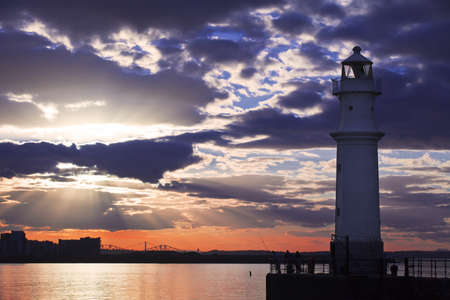 Lighthouse at astonishing sunset with vivd sky in Edinburgh, Scotland photo