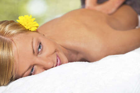 Young blond caucasian woman receiving back massage at Beauty Spa salon. Horisontal Stock Photo - 15007559