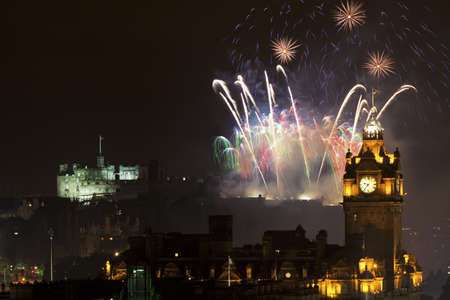 clock tower: Edinburgh Cityscape with fireworks over The Castle and Balmoral Clock Tower
