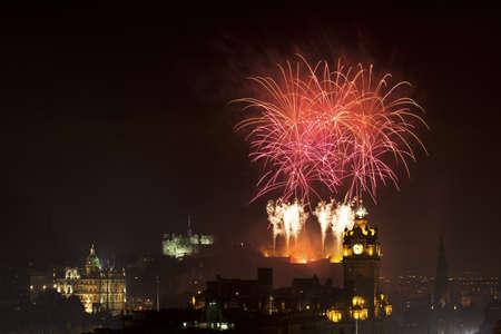 edinburgh: Edinburgh Cityscape with fireworks over The Castle and Balmoral Clock Tower