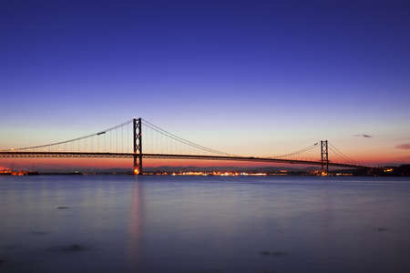 The Forth Road Bridge at dusk in Edinburgh, South Quennsferry, Scotland photo