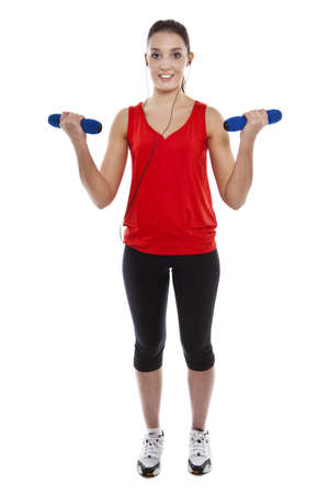 Young pretty fit woman exercising with weights while listening music. Studio Isolated on white. High key Stock Photo - 15529426