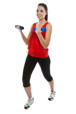 Young pretty fit woman exercising with weights while listening music. Studio Isolated on white. High key Stock Photo - 15529421