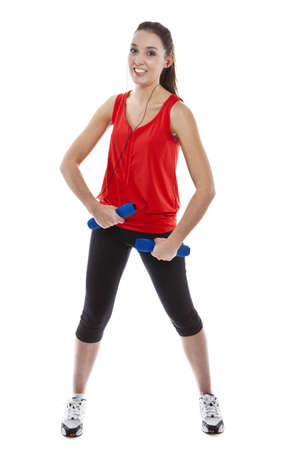 Young pretty fit woman exercising with weights while listening music. Studio Isolated on white. High key Stock Photo - 15529423