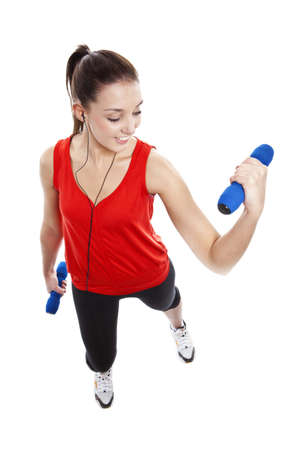 Young pretty fit woman exercising with weights while listening music. Studio Isolated on white. High key Stock Photo - 15529425