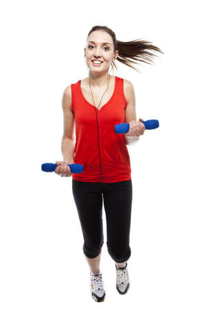 Young pretty fit woman exercising with weights while listening music. Studio Isolated on white. High key Stock Photo - 15529420