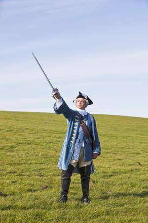 tricorne: Reenactor in 18th century British army infantry officer uniform