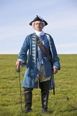 british man: Reenactor in 18th century British army infantry officer uniform