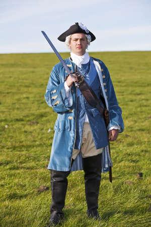 Reenactor in 18th century British army infantry officer uniform photo