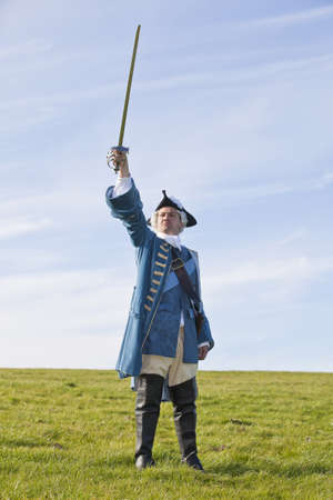 18th: Reenactor in 18th century British army infantry officer uniform