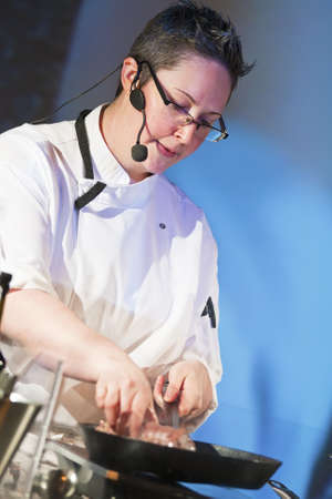 Female chef at cooking demonstration on stage.  Stock Photo - 15472970