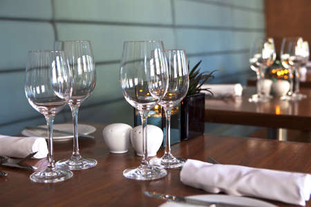 Formal dining table set up in stylish luxury restaurant. Selective focus. Shallow depth of field photo