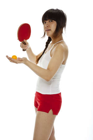 Asian woman with tennis racket isolated on black photo