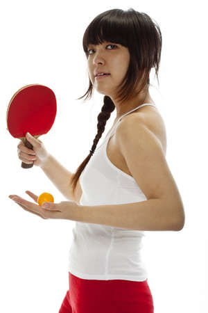 Young Asian woman with a table tennis racket isolated on white. photo