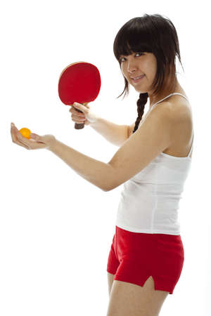 Young Asian woman with a table tennis racket isolated on white. Stock Photo