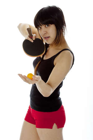 perspiring: Young Asian woman with a ping-pong racket isolated on white  Closeup, vertical composition Stock Photo