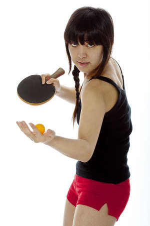 Young Asian woman with a ping-pong racket isolated on white  Closeup, vertical composition photo