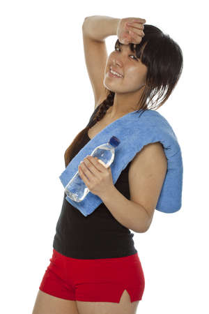 Young Asian woman with a bottle of water isolated on white  Closeup, vertical composition photo