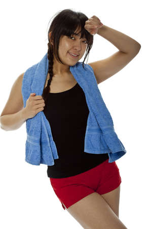 Pretty young Asian woman with towel after fitness. Isolated on white, studio shot, closeup Stock Photo - 15892547